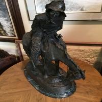 bronze-horseback-rider-statue-14263030491.jpg