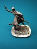 cowboy-bronze-by-russell-1425833270.jpg