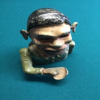 metal-penny-bank-head-14266476281.jpg