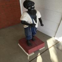 sculpture-of-boy-in-overalls-1426303969.jpg