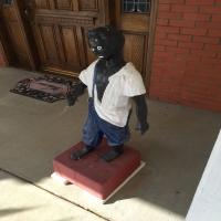 sculpture-of-boy-in-overalls-14263039691.jpg