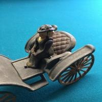vintage-woman-in-carriage-metal-toy-1426649341.jpg