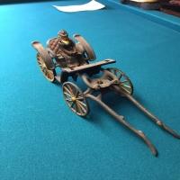 vintage-woman-in-carriage-metal-toy-14266493412.jpg