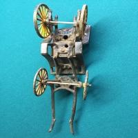 vintage-woman-in-carriage-metal-toy-14266493414.jpg
