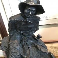 bronze-horseback-rider-statue-14263030492.jpg