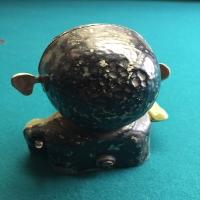 metal-penny-bank-head-1426647628.jpg