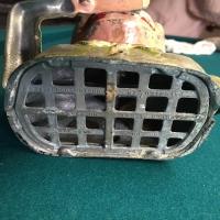 metal-penny-bank-head-1426647666.jpg