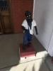sculpture-of-boy-in-overalls-1426303937.jpg