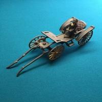 vintage-woman-in-carriage-metal-toy-1426649266.jpg