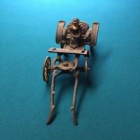 vintage-woman-in-carriage-metal-toy-14266493411.jpg