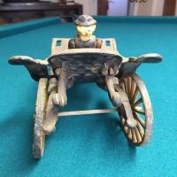 vintage-woman-in-carriage-metal-toy-14266493413.jpg