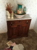 wooden-cabinet-with-hand-painted-ceramic-dishware-1426655167.jpg