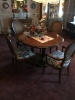 wooden-oval-dining-table-set-with-chairs-1426655627.jpg